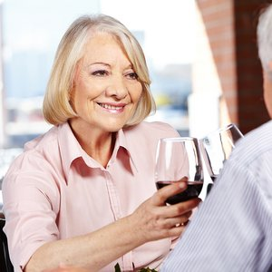 bigstock-Happy-senior-woman-drinking-a-52131778.jpg