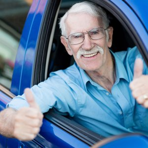 bigstock-Man-driving-a-car-and-showing-37191019.jpg