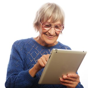 bigstock-Senior-happy-woman-using-ipad-73149421.jpg