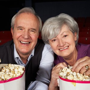 bigstock-Senior-Couple-Watching-Film-In-38636263.jpg