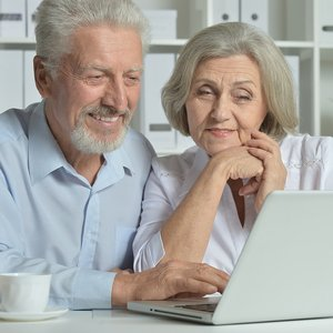 bigstock-happy-senior-couple-with-lapto-111149168.jpg